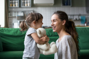 Woman smiling at foster child who is there for respite foster care