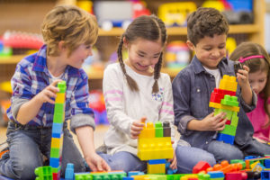 Foster children being introduced to one another while playing with blocks