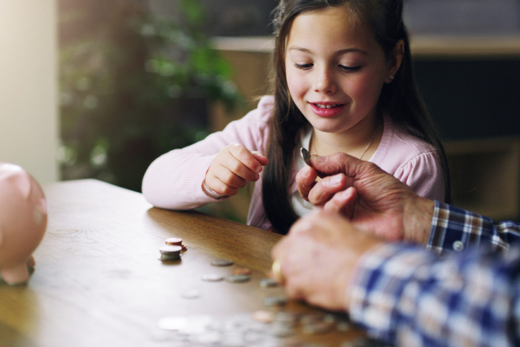 Shot of a little girl learning about money.