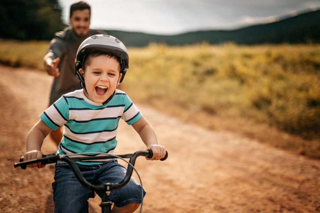 teaching a kid to ride his bike - foster care myths